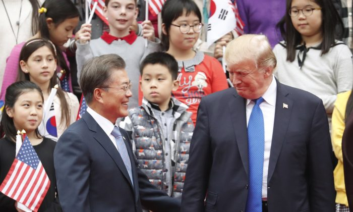 US President Donald Trump (R) and South Korea's President Moon Jae-in at the presidential Blue House in Seoul on Nov. 7, 2017. (KIM HONG-JI/AFP/Getty Images)