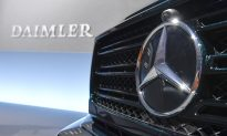 Daimler Cuts Dividend as Downturn, R&D Costs Hit Mercedes