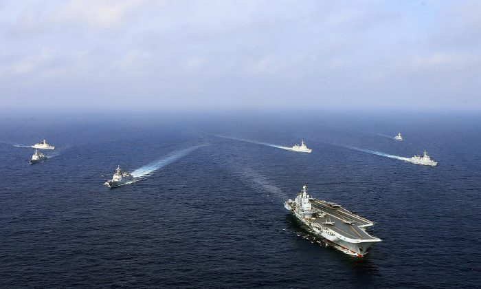 This undated photo taken in April 2018 shows China's sole operational aircraft carrier, the Liaoning (front), sailing with other ships during a drill at sea. (AFP/Getty Images)