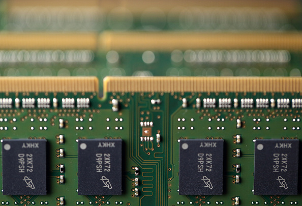 Micron Technology Inc. Double-Data-Rate Synchronous Random-Access Memory (SDRAM) chips are arranged for a photograph in Tokyo, Japan, on Wednesday, July 15, 2015. (Tomohiro Ohsumi/Bloomberg via Getty Images)