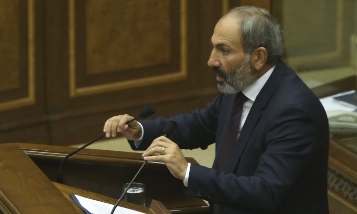 Armenian opposition leader Nikol Pashinyan addresses lawmakers during a parliament session to elect an interim prime minister in Yerevan, Armenia May 1, 2018. (Reuters/Vahram Baghdasaryan/Photolure)