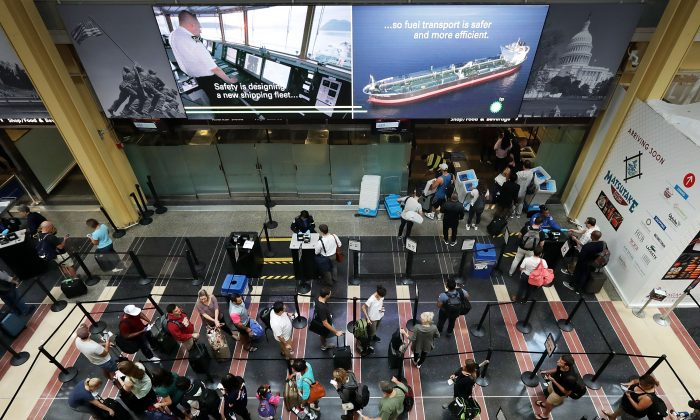 Travelers move through one of the Transportation Security Administration (TSA) lines at Ronald Reagan National Airport's Terminal B and C Sept. 1, 2017 in Washington. (Chip Somodevilla/Getty Images)