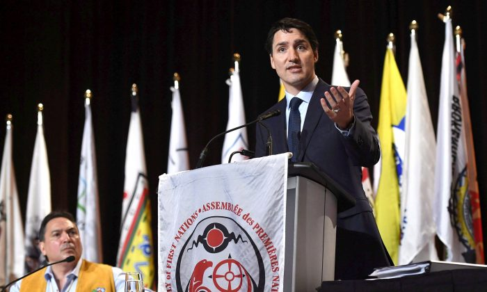 Prime Minister Justin Trudeau delivers an address at the Assembly of First Nations Special Chiefs Assembly as National Chief Perry Bellegarde looks on, in Gatineau, Que., on May 2, 2018. (The Canadian Press/Justin Tang)