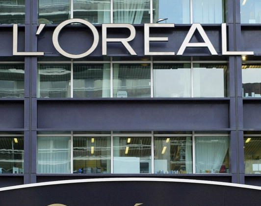 FRANCE - FEBRUARY 18:  Logos above the main entrance of the L'Oreal SA headquarters in Clichy, near Paris, France. (Photo by Patrick Durand/Bloomberg via Getty Images)