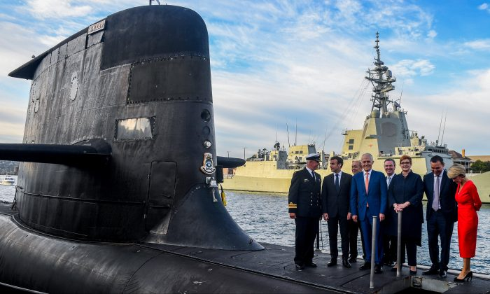 Australian Prime Minister Malcolm Turnbull, President of France Emmanuel Macron, Australian Minister for Defence Industry Christopher Pyne, Australian Minister for Defence Marise Payne and Australian Minister for Foreign Affairs Julie Bishop are seen on the submarine HMAS Waller at Garden Island, in Sydney May 2, 2018.   (AAP/Brendan Esposito/via Reuters)