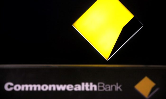 A Commonwealth Bank logo adorns an Automatic Tellar Machine (ATM) located in Sydney, Australia Nov. 12, 2014.  (Reuters/David Gray/File Photo)