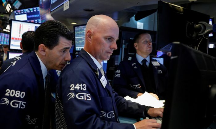 Traders work on the floor of the New York Stock Exchange (NYSE) in New York on May 3, 2018. (REUTERS/Brendan McDermid)