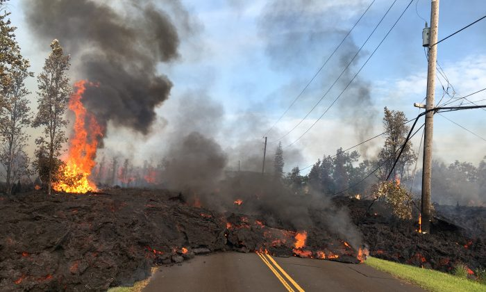 Lava advances along a street near a fissure in Leilani Estates, on Kilauea Volcano's lower East Rift Zone, Hawaii, the U.S., May 5, 2018. (U.S. Geological Survey/Handout via Reuters)
