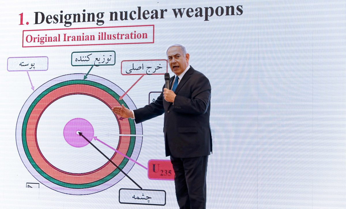 Israeli Prime Minister Benjamin Netanyahu delivers a speech on Iran's nuclear program at the defense ministry in Tel Aviv