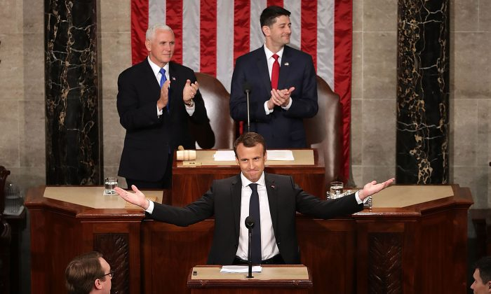French President Emmanuel Macron is welcomed with a standing ovation during a joint meeting of the U.S. Congress in the House Chamber with U.S. Vice President Mike Pence and Speaker of the House Paul Ryan (R-WI) at the U.S. Capitol April 25, 2018 in Washington, DC.  (Chip Somodevilla/Getty Images)