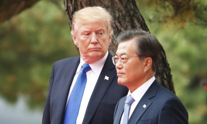 U.S. President Donald Trump and South Korea's President Moon Jae-in attend a welcoming ceremony at the presidential Blue House in Seoul on Nov. 7, 2017. (Kim Hong-Ji/AFP/Getty Images)