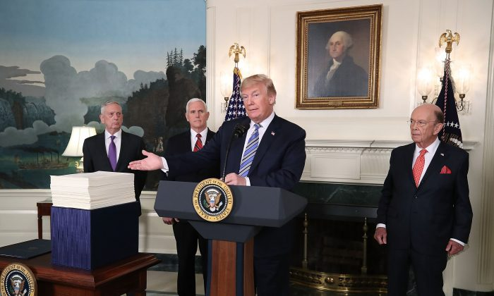 President Donald Trump criticizes the $1.3 trillion spending bill passed by Congress, with Vice President Mike Pence (2nd-L), Defense Secretary Jim Mattis, (L), and Commerce Secretary Wilbur Ross (R) in the Diplomatic Room of the White House on March 23, 2018 in Washington, DC.. before he reluctantly signed it. A message Trump will send to Congress on May 8 requesting rescissions from the federal budget will give him a means to begin reducing federal spending (Mark Wilson/Getty Images)