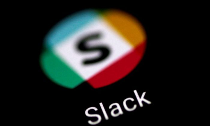 The Slack messaging application is seen on a phone screen Aug. 3, 2017. (Reuters/Thomas White/File Photo)