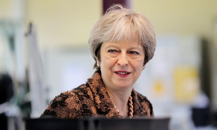 Britain's Prime Minister Theresa May visits the Oxley Group in Ulverston, April 30, 2018.  (Christopher Furlong/Pool via Reuters)