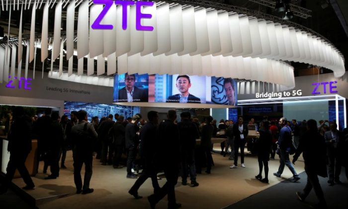 People stand at ZTE's booth during the Mobile World Congress in Barcelona, Spain, on February 27, 2017. (Paul Hanna/File Photo/Reuters)