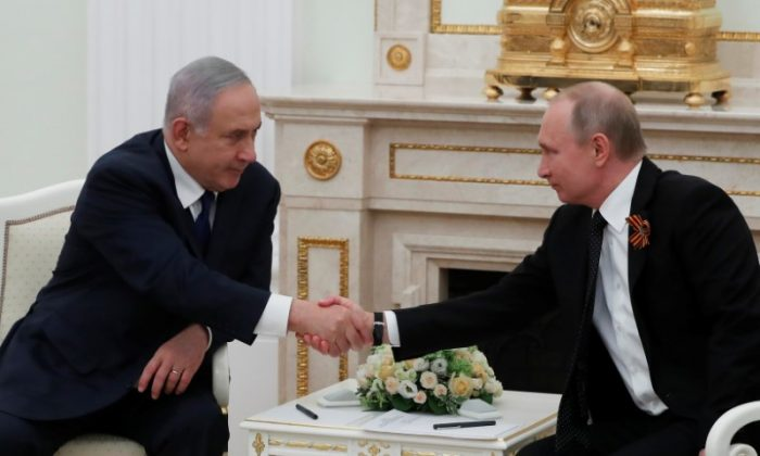 Russian President Vladimir Putin and Israeli Prime Minister Benjamin Netanyahu shake hands during a meeting at the Kremlin in Moscow, Russia May 9, 2018. (Sergei Ilnitsky/Pool via Reuters)