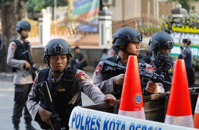 Police take position outside the Mobile Police Brigade (Brimob) headquarters in Depok, Indonesia, May 10, 2018. (Reuters/Darren Whiteside)