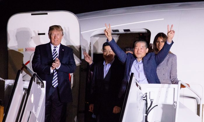 President Donald Trump and first lady Melania Trump greet the three Americans just released from North Korea, Kim Dong Chul, Kim Hak-song and Tony Kim, upon their arrival on May 10, 2018 at Joint Base Andrews, Maryland. Secretary of State Mike Pompeo traveled to North Korea and returned with the three men who have been detained in North Korea. (Samira Bouaou/The Epoch Times)