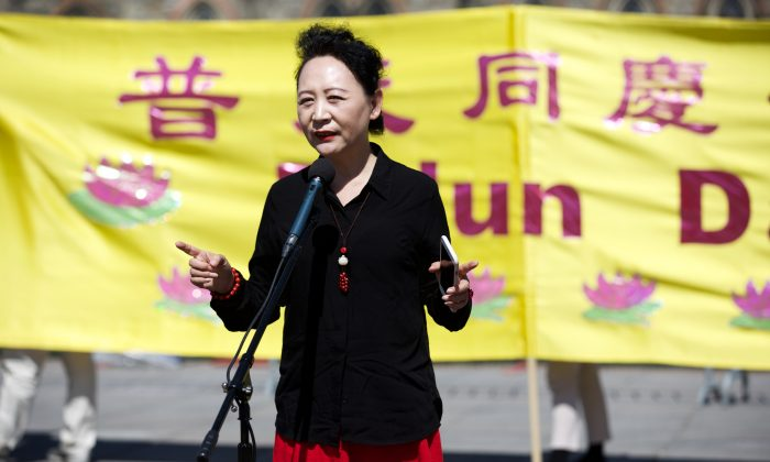 Activist Sheng Xue addresses the crowd celebrating the Falun Dafa Day on the Parliament Hill in Ottawa on May 9, 2018. (Evan Ning/The Epoch Times)