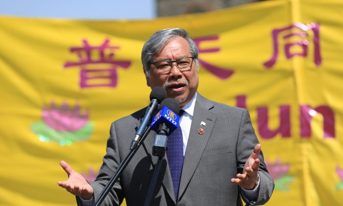 Senator Thanh Hai Ngo addresses the crowd celebrating Falun Dafa Day on Parliament Hill in Ottawa on May 9, 2018. Ngo is one of the parliamentarians calling on the Canadian government to apply Magnitsky sanctions against Chinese officials for human rights abuses in China.(Jonathon Ren/The Epoch Times)