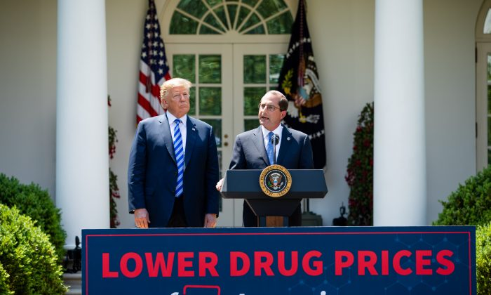 President Donald Trump (L) and Secretary of Health and Human Services Alex Azar give remarks on lowering drug prices in the Rose Garden of the White House in Washington on May 11, 2018. (Samira Bouaou/The Epoch Times)