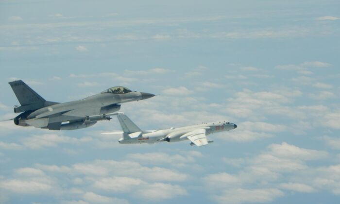 A Taiwanese Air Force F-16 fighter jet flies alongside a Chinese People's Liberation Army Air Force (PLAAF) H-6K bomber in the western Pacific, one of the Chinese military aircraft that reportedly flew over Bashi Channel and Miyako Strait near Japan's Okinawa island chain on the morning of May 11, 2018. (Released by Taiwan ROC Air Force)