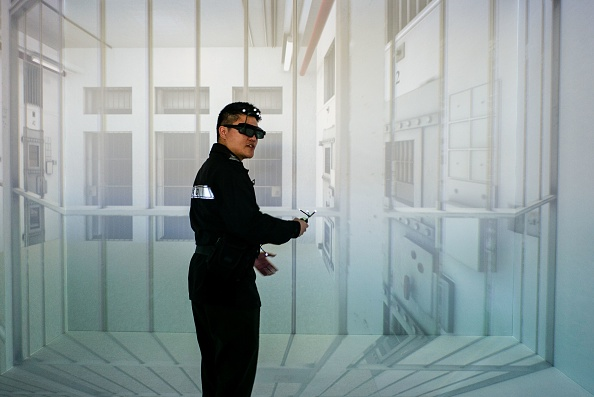 A Correctional Services Department officer interacts with a virtual reality training exercise program during a demonstration for the media at the CSD Staff Training Institute in the district of Stanley in Hong Kong on Feb. 27. (ANTHONY WALLACE/AFP/Getty Images)