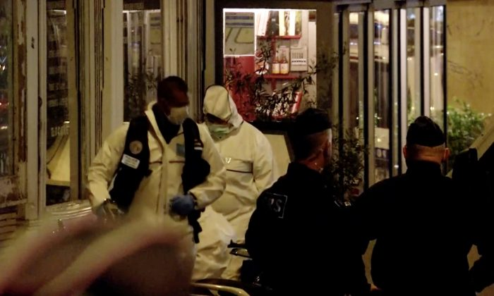 Police guard the scene of a knife attack in Paris, France May 12, 2018 in this still image obtained from a video. (Reuters/Reuters TV)