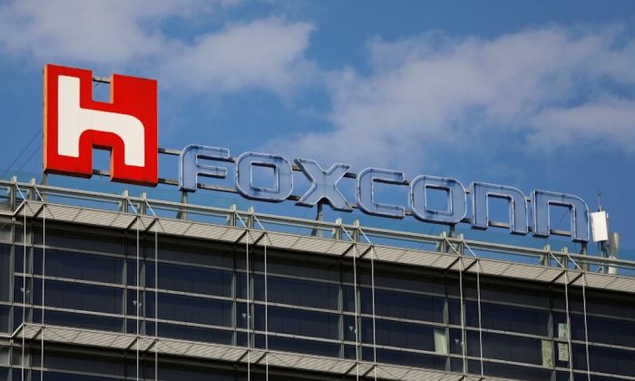 The logo of Foxconn, the trading name of Hon Hai Precision Industry, is seen on top of the company's building in Taipei, Taiwan on March 30, 2018. (Tyrone Siu/Reuters)