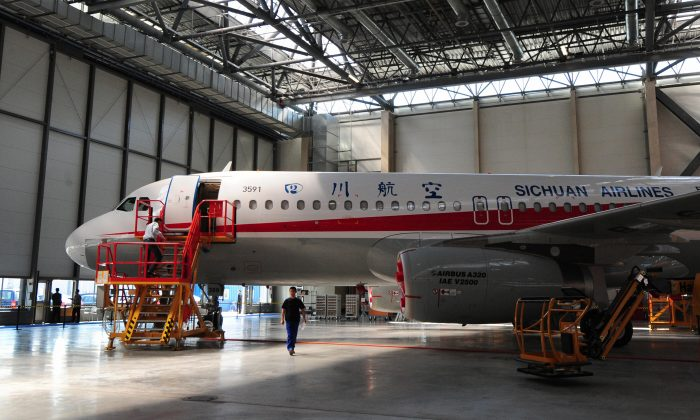A Sichuan Airlines A320 jet inside a hangar at the Airbus Tianjin factory in Tianjin City, northern China on April 21, 2009. (Frederic J. Brown/AFP/Getty Images)