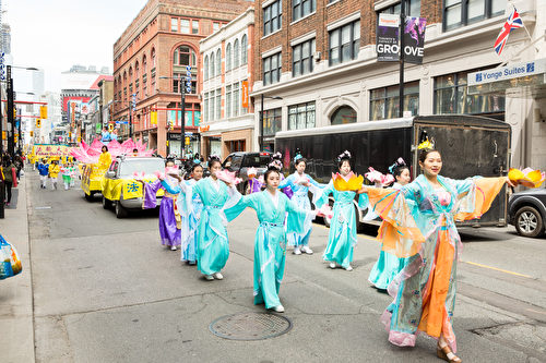 Falun Dafa adherents perform in a parade to celebrate Falun Dafa Day in Toronto on May 12, 2018. (Evan Ning/The Epoch Times)