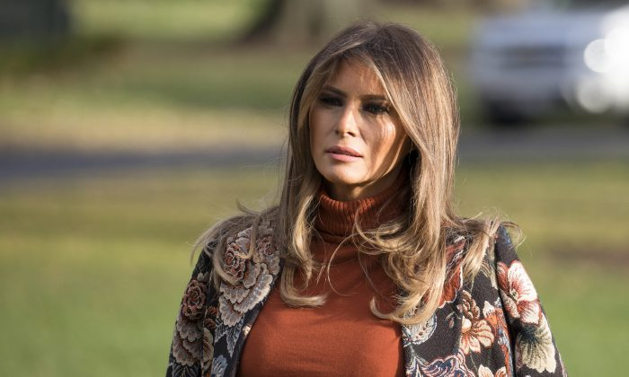 First Lady Melania Trump waits as President Donald Trump talks to reporters before departing with his family from the White House on Nov. 21, 2017, to his Mar-a-Lago resort in Florida for the Thanksgiving holiday. (Samira Bouaou/The Epoch Times)