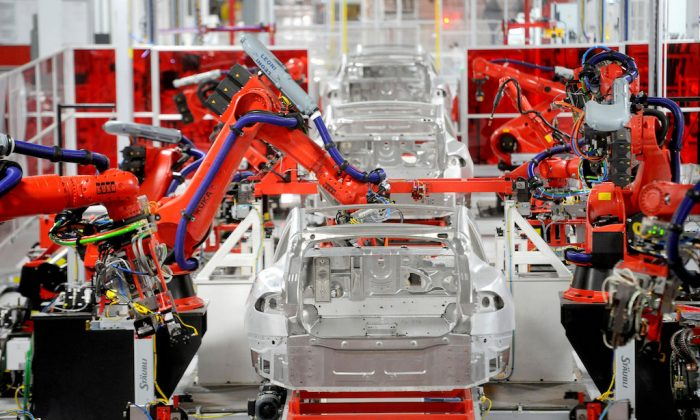 Robotic arms assemble Tesla's Model S sedans at the company's factory in Fremont, Calif., on June 22, 2012.  (REUTERS/Noah Berger/File Photo)