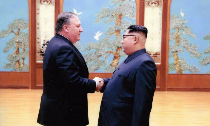 CIA director Mike Pompeo (L) shakes hands with North Korean leader Kim Jong Un in Pyongyang, North Korea on March 31, 2018. (Photo by The White House via Getty Images)
