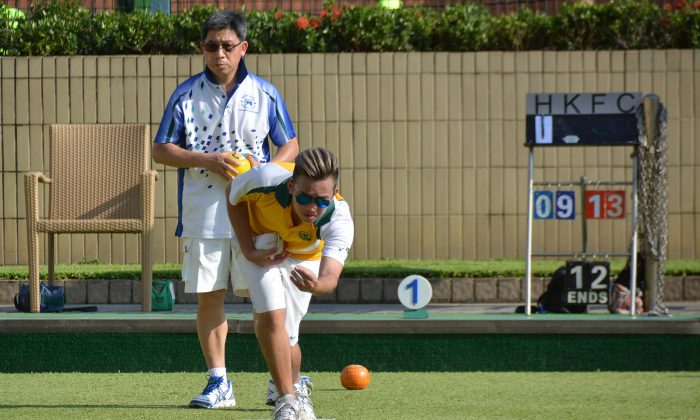 Jordi Lo (delivering) from Craigengower Cricket Club on his way to defeating Hong Kong Football Club's CT Wong in the second league match of the 2018 season.  CCC won 6-2 and moved to top of the table, on Saturday May 12, 2018. (Stephanie Worth)