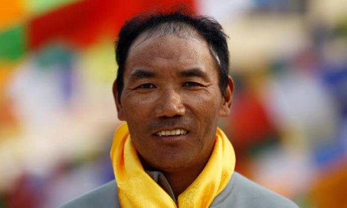 Kami Rita Sherpa, 48, who is attempting a world record by climbing Mount Everest for the 22nd time this season, poses for a picture at Boudhanath Stupa in Kathmandu, Nepal March 26, 2018. (REUTERS/Navesh Chitrakar)