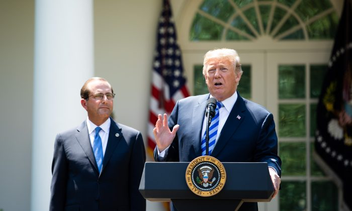 President Donald Trump and Secretary of Health and Human Services Alex Azar give remarks on lowering drug prices in the Rose Garden of the White House on May 11.  (Samira Bouaou/The Epoch Times)