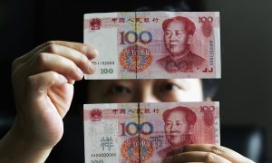 Fearing Depreciation, Chinese Are Breaking the Law to Move Their Money Abroad