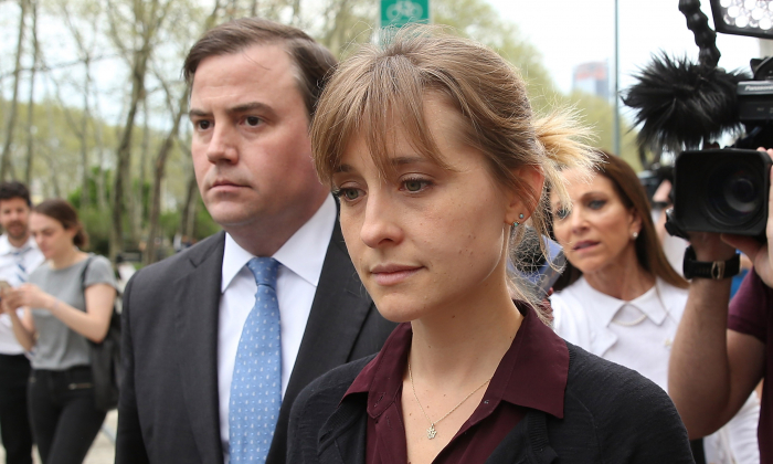 Actress Allison Mack (R) departs the United States Eastern District Court after a bail hearing in relation to the sex trafficking charges filed against her on May 4, 2018 in the Brooklyn borough of New York City. (Jemal Countess/Getty Images)