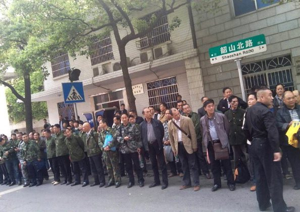 This undated mobile phone picture shows former soldiers participating in a protest outside the provincial government building in Changsha, central China's Hunan province. Marginalised and misunderstood, Chinese Vietnam veterans -- who fought in a little-celebrated war with its southern neighbor -- risk beatings and prison in a new battle with the CCP officials. (STR/AFP/Getty Images)