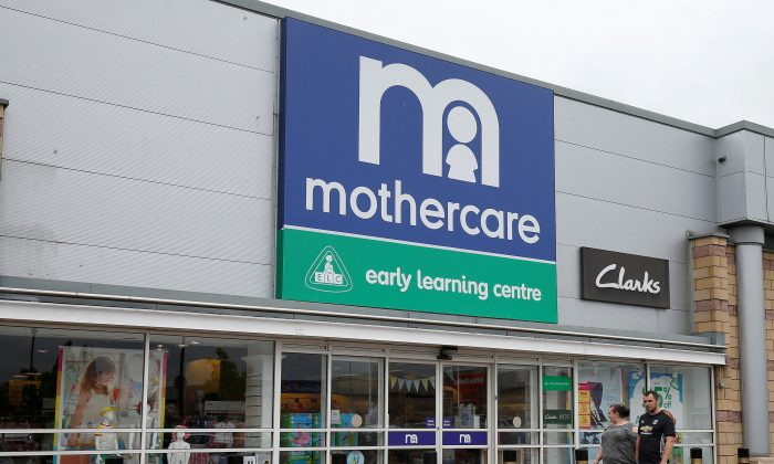 People walk past a Mothercare store in Altricham, Britain, May 16, 2018. (Reuters/Andrew Yates)