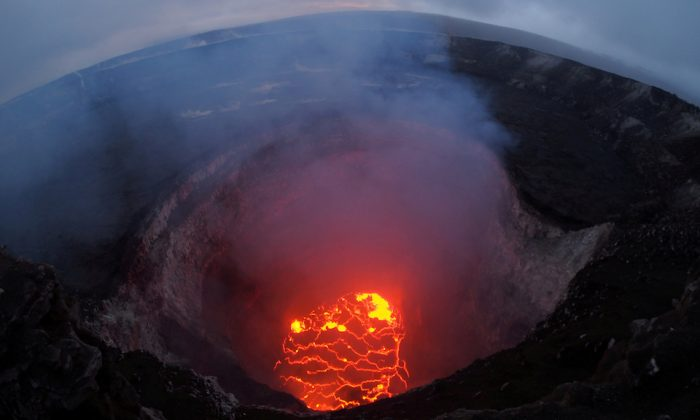 Kilauea volcano's summit lava lake shows a significant drop of roughly 722 feet below the crater rim in this wide angle camera view showing the entire north portion of the Overlook crater May 6, 2018.  (USGS/Handout via REUTERS)