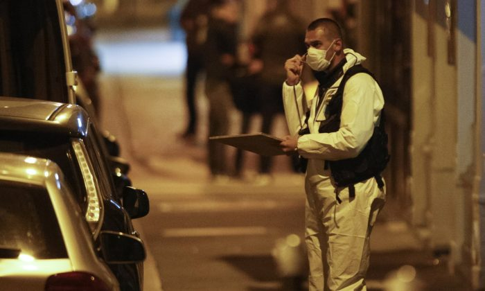 A forensic officer  in Paris after one person was killed and several injured by a man armed with a knife, who was shot dead by police in Paris on May 12, 2018. ( Geoffery Van Der Hasselt/AFP/Getty Images)