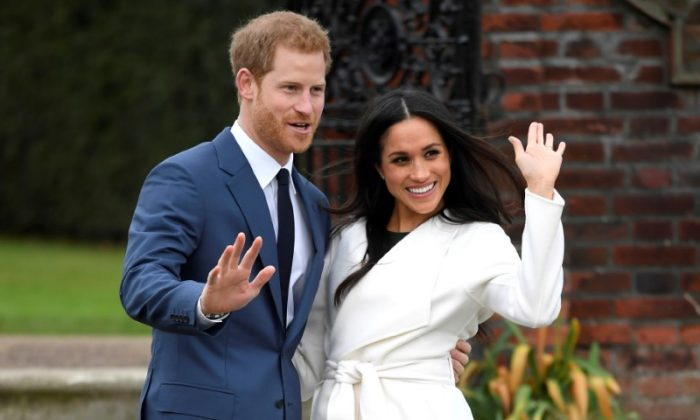 Britain's Prince Harry poses with Meghan Markle in the Sunken Garden of Kensington Palace, London, Britain, November 27, 2017. (Reuters/Toby Melville)