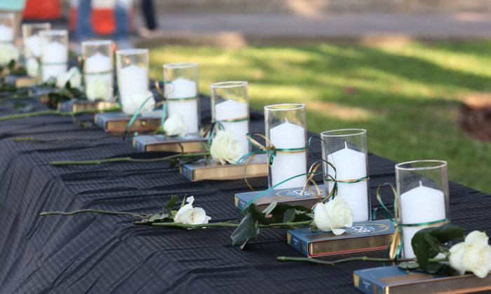 Candles line a table during a vigil held at the Texas First Bank after a shooting left several people dead at Santa Fe High School in Santa Fe, Texas on May 18, 2018.  (REUTERS/Trish Badger)
