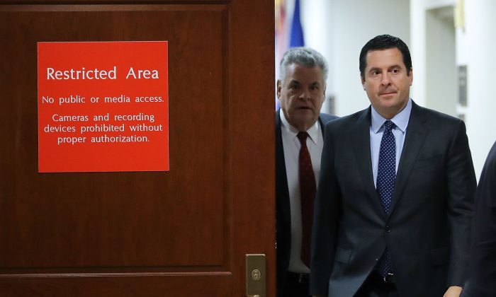 House Intelligence Committee Chairman Devin Nunes (R-CA) (2nd L) and Rep. Peter King (R-NY) leave the committee's secure meeting rooms in the basement of the U.S. Capitol House Visitors Center in Washington, D.C., on Feb. 6, 2018 . (Chip Somodevilla/Getty Images)
