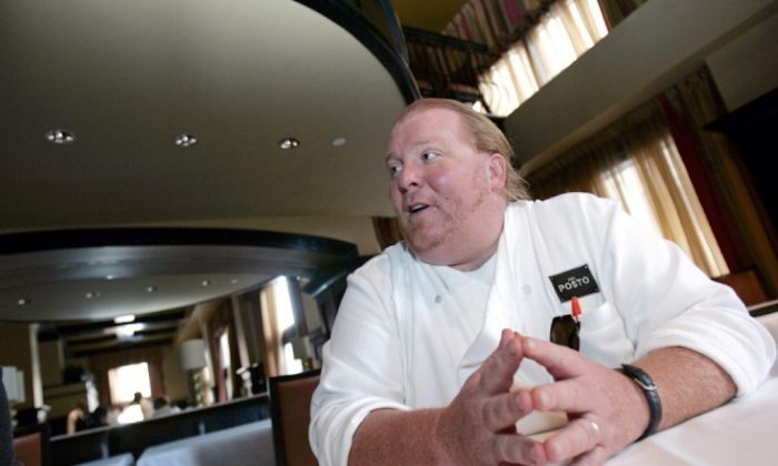 Celebrity chef Mario Batali talks during an interview with Reuters at his latest restaurant, Del Posto, in New York on April 11, 2006.  (REUTERS/Brendan McDermid)