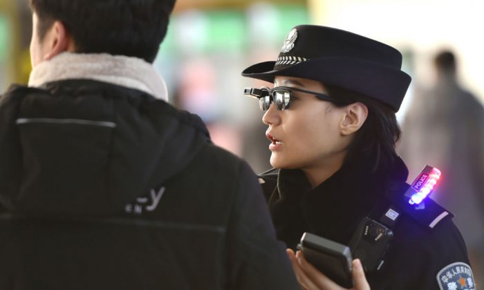 A police officer (R) speaks as she wears a pair of smartglasses with a facial recognition system at Zhengzhou East Railway Station in Zhengzhou, Henan Province, on Feb. 5, 2018.  (AFP/Getty Images)
