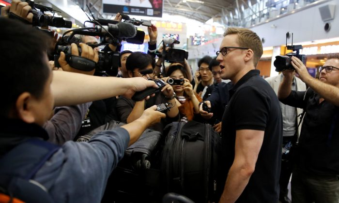 CNN's Will Ripley talks to the media after arriving at the airport to board a plane to North Korea in Beijing, China, May 22, 2018. (Reuters/Thomas Peter)