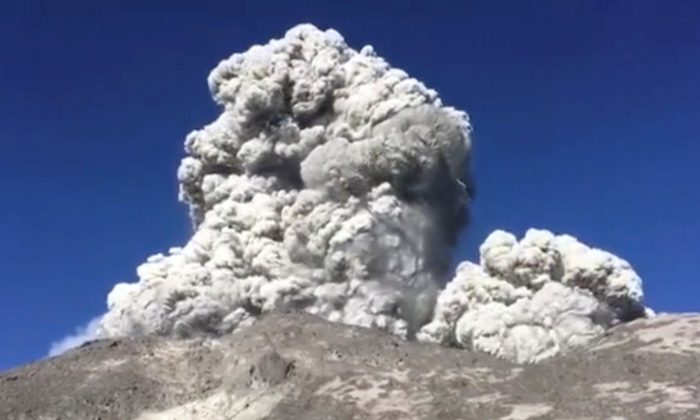 A volcano is seen erupting in Central Java, Indonesia, in this May 11, 2018 still image taken from a video obtained from social media. (Shopan Pangestu/via Reuters)